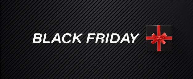 Zwarte vrijdag verkoop banner met zwarte geschenkdoos en rood lint en witte witte tekst op textuur achtergrond.