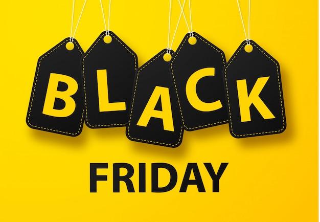 Zwarte vrijdag verkoop banner ontwerp lay-out op een gele achtergrond, gestileerde letters in zwarte labels.