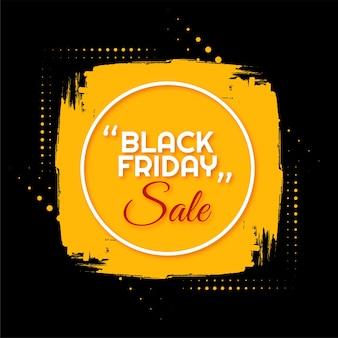 Zwarte vrijdag verkoop gele penseelstreek frame achtergrond