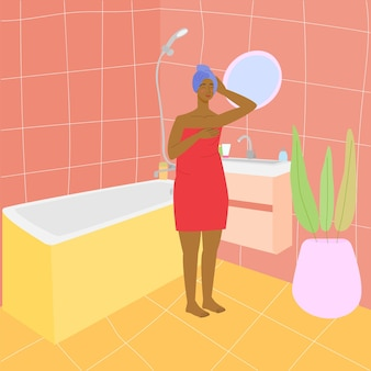 Zwarte vrouw in de badkamer meisje in een handdoek in de badkamer badkamer interieur