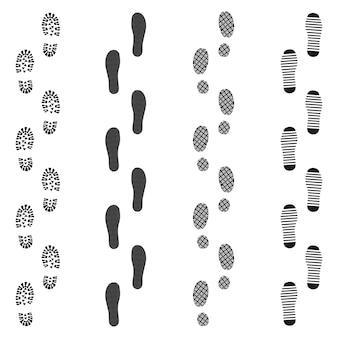 Zwarte vuile voetafdrukset
