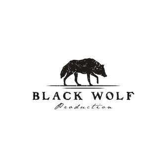 Zwarte wolf fox hond coyote jackal rustieke vintage silhouet retro hipster logo ontwerp wandelen