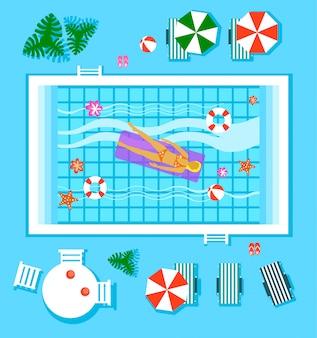 Zwembad in bovenaanzicht met buitenelement.