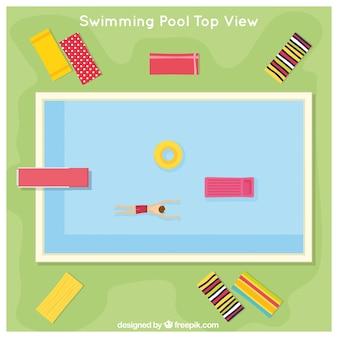 Zwembad in een bovenaanzicht met ligstoelen