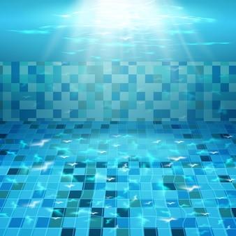Zwembad met blauw water. textuur van wateroppervlak en betegelde bodem