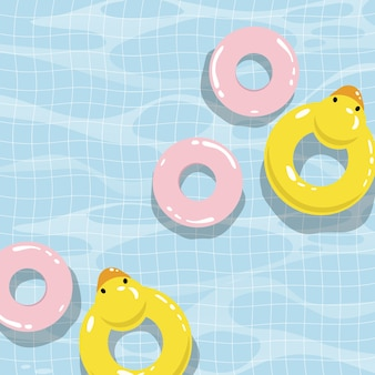 Zwembad met kleurrijke drijvers bovenaanzicht