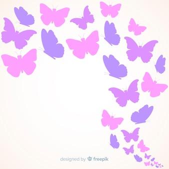 Zwerm vlinder silhouetten achtergrond